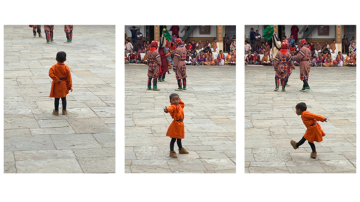 dancing toddler in local Bhutanese habit